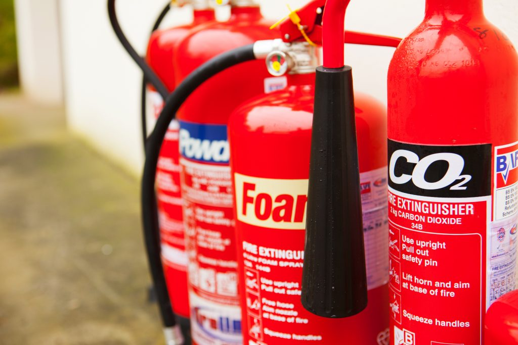 Large picture of 4 fire extinguishers