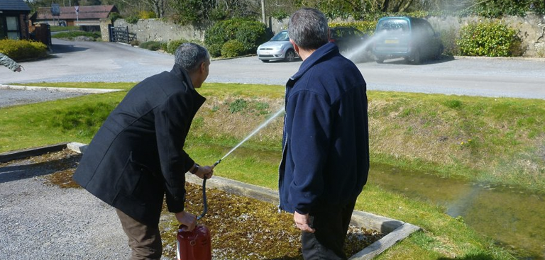 Man demonstrating a fire extinguisher in training by Fireline UK