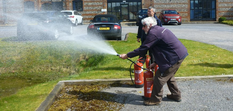 Man with a Fire Extinguisher in a training by Fireline UK