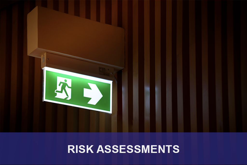 Photograph of a fire extinguisher lit up with the word risk assessment on a blue overlay