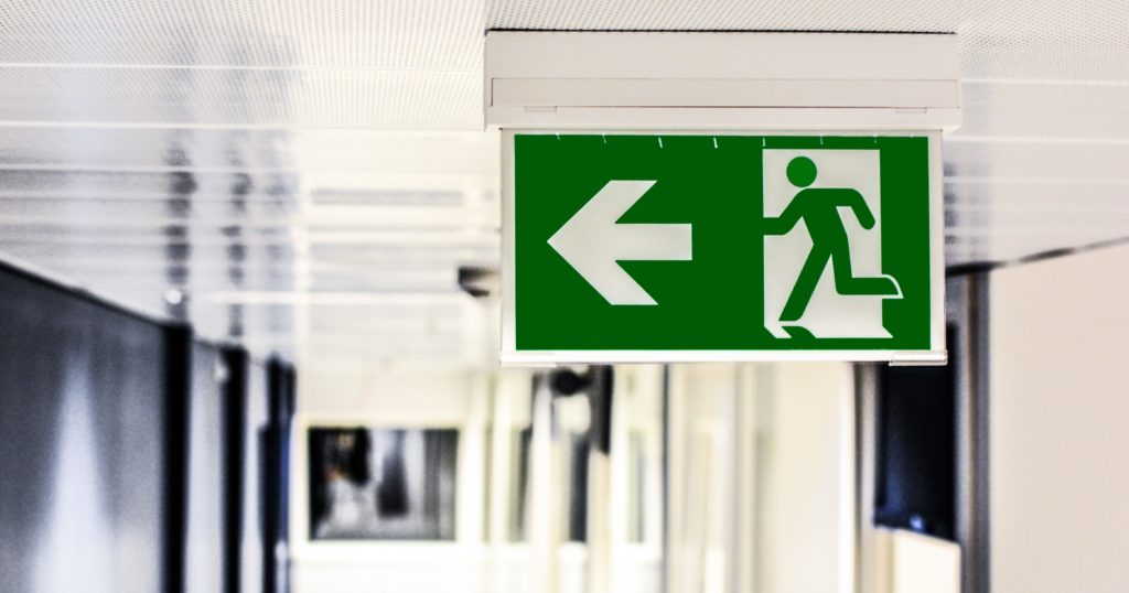 Photograph of a fire exit sign on the ceiling