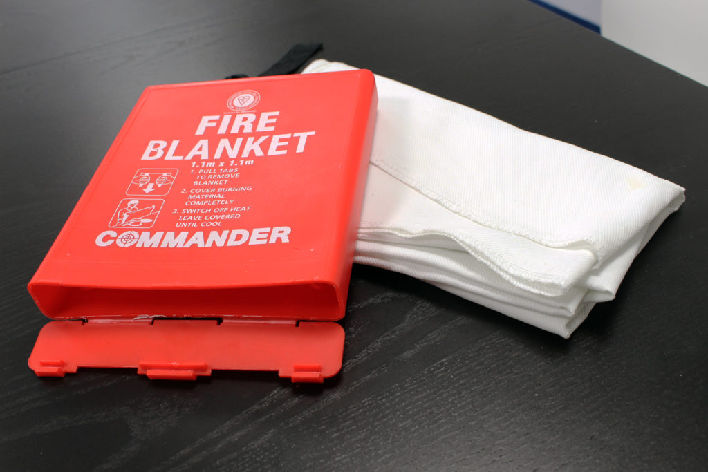 Photograph of a fire blanket on a desk