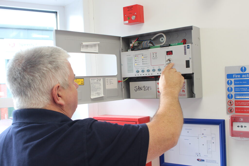 Photograph of a Fireline engineer testing fire equipment