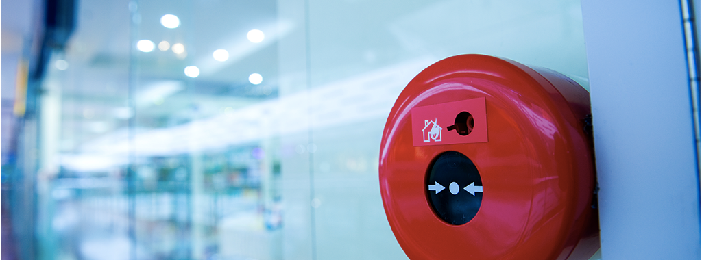 red fire alarm system installed on a wall
